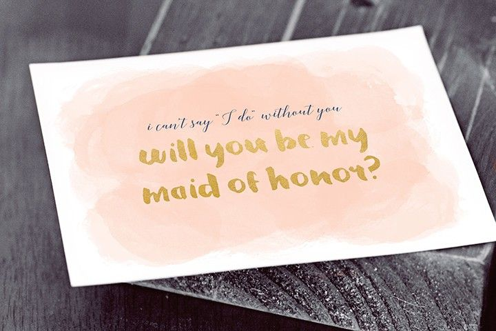 A Will You Be My Maid of Honor? card on a table