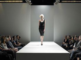 Spectators watching a fashion model on a catwalk