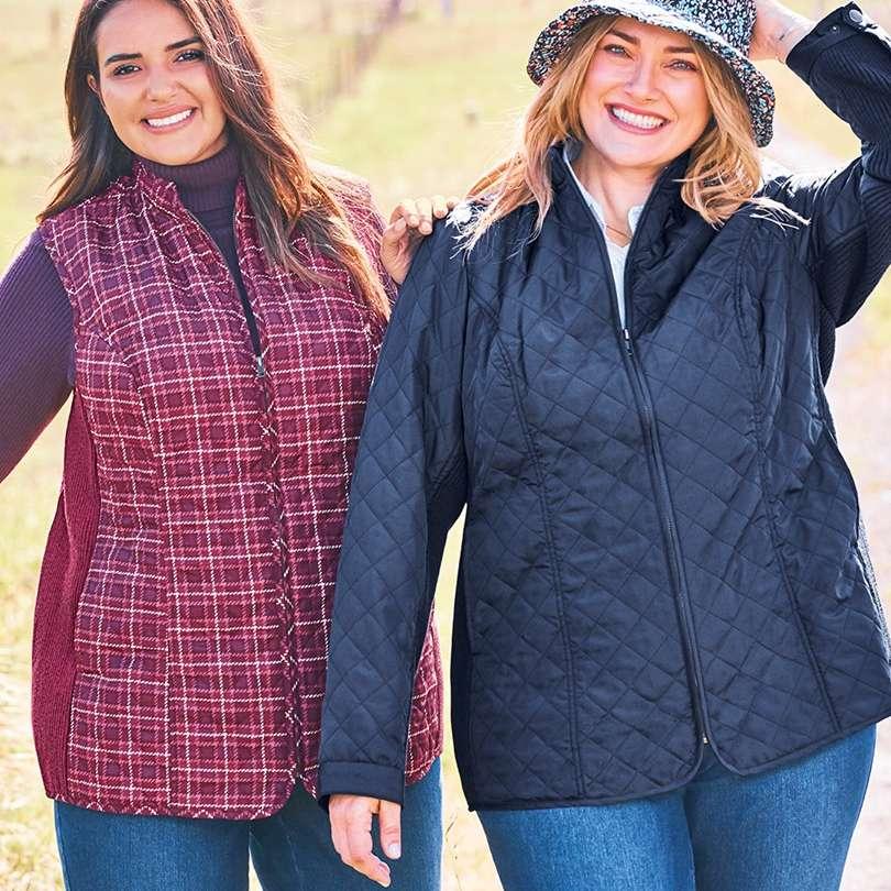 Two women wearing jackets outside