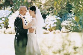 Newlywed Couple Dancing Together in a Garden