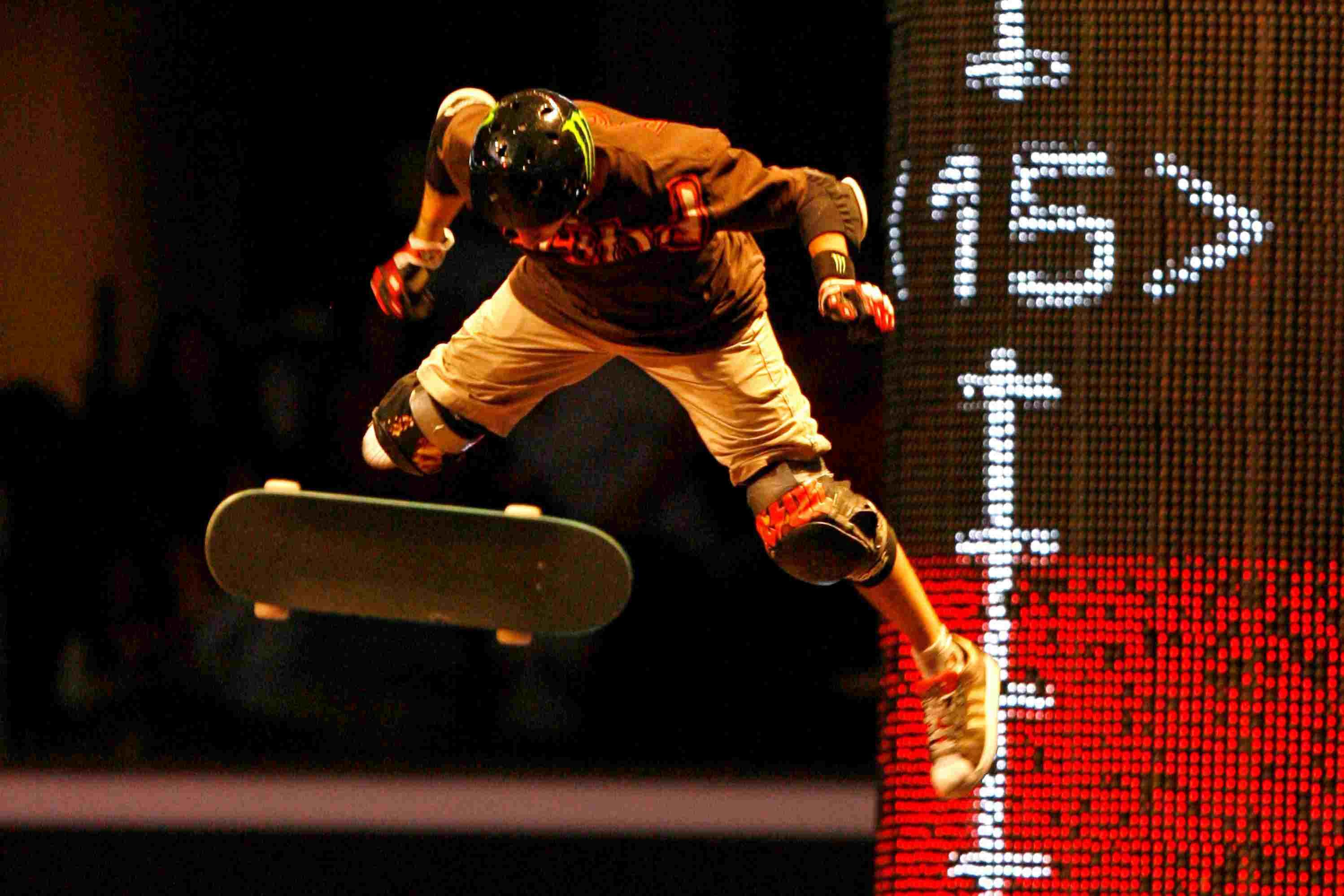 Jake Brown gets big air on his skateboard as gravity pulls him down