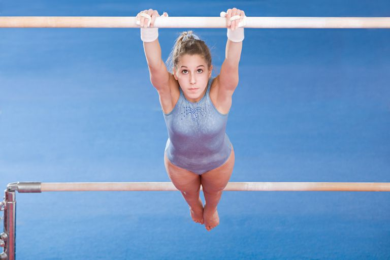 Teenage Gymnast on uneven bars