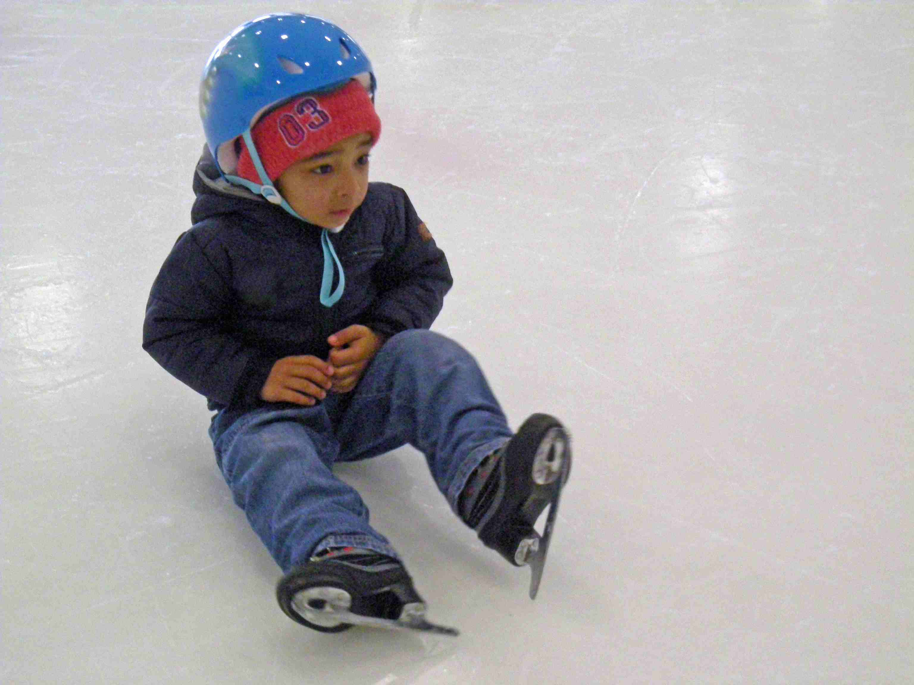 young ice skater with a helmet