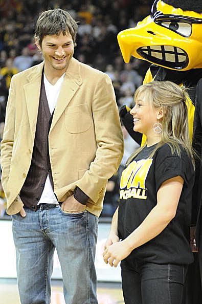 Gymnast Shawn Johnson and actor Ashton Kutcher are honored at the Iowa-Iowa State basketball game.