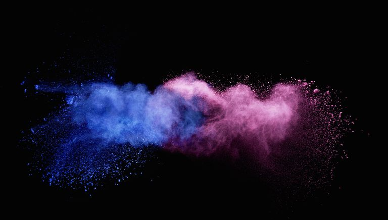 Explosion of blue and pink powder