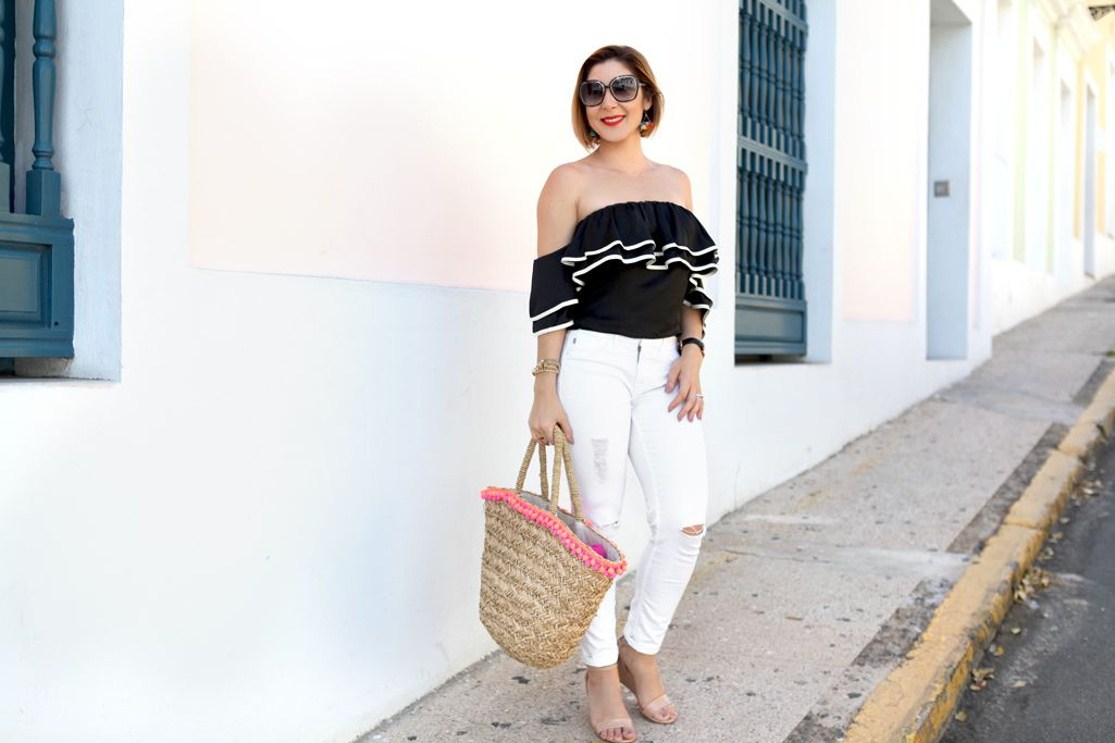Woman in chic black and white summer outfit