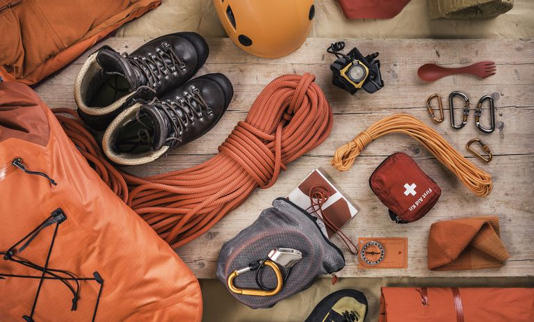 Overhead view of climbing equipment on wood floor.