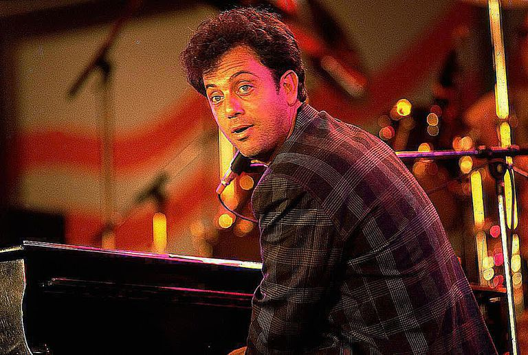Billy Joel at a piano