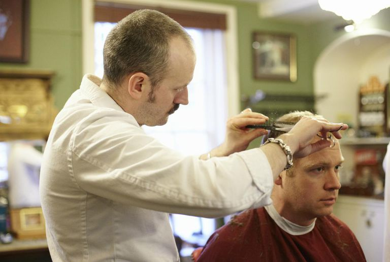 Barber cutting mans hair