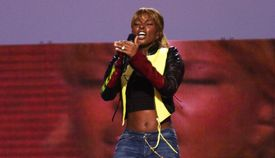 Mary J. Blige performing on stage.