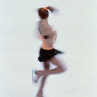 A girl doing a basic Upright One Foot Spin
