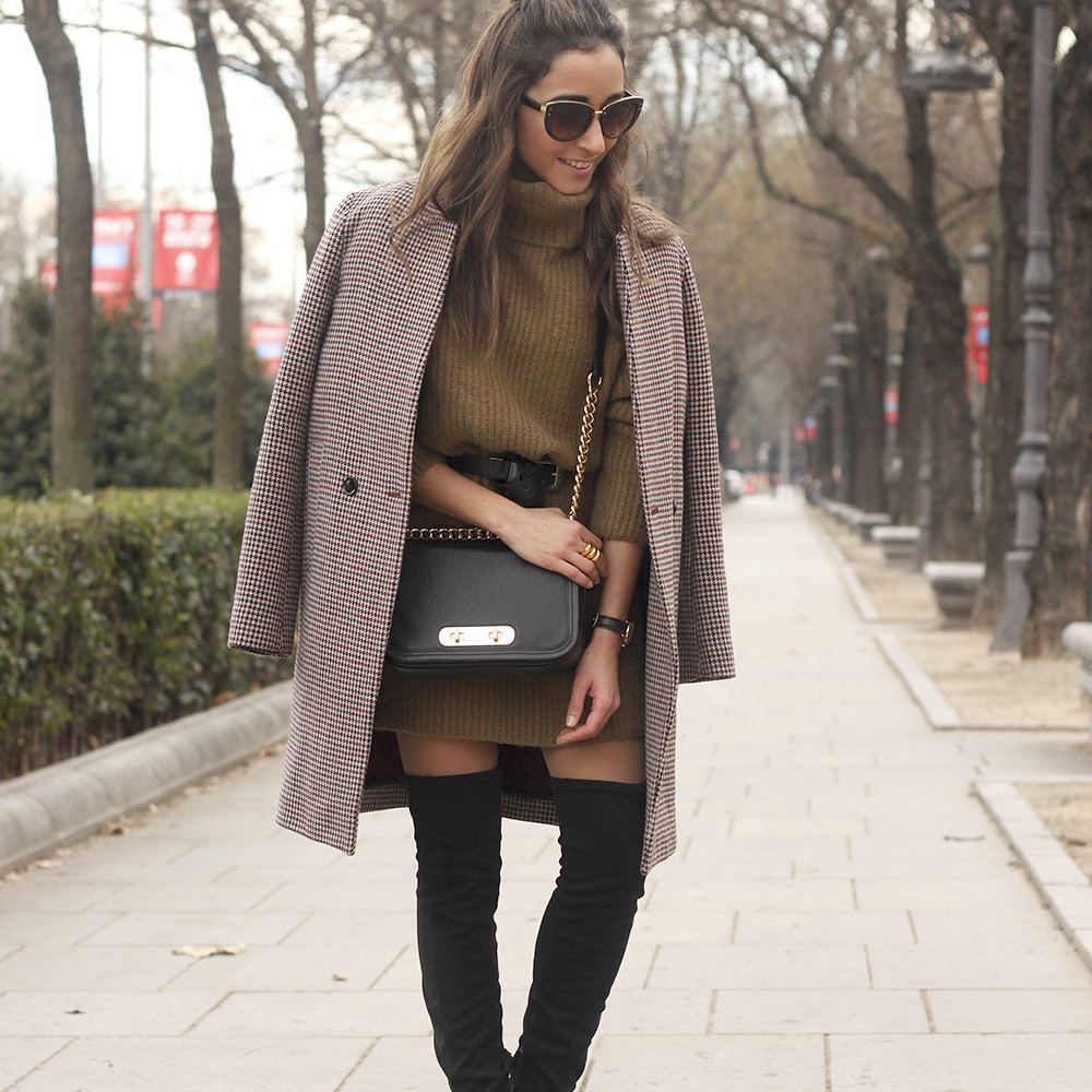 af04b23aa9e69 Woman in sweater dress and winter coat and tall boots