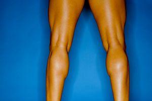 Rear view of bodybuilder's muscular legs