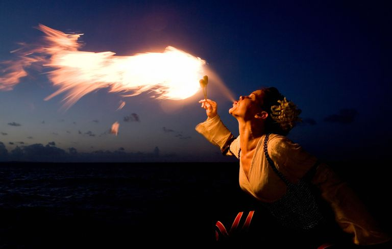 Woman breathing fire