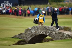 Paul Lawrie of Scotland walks over Swilcan Bridge during the third round of the 144th Open Championship at The Old Course on July 19, 2015 in St Andrews, Scotland