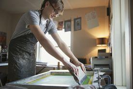 Artist working on silk screen