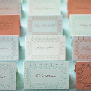 More than a dozen wedding place cards on a table