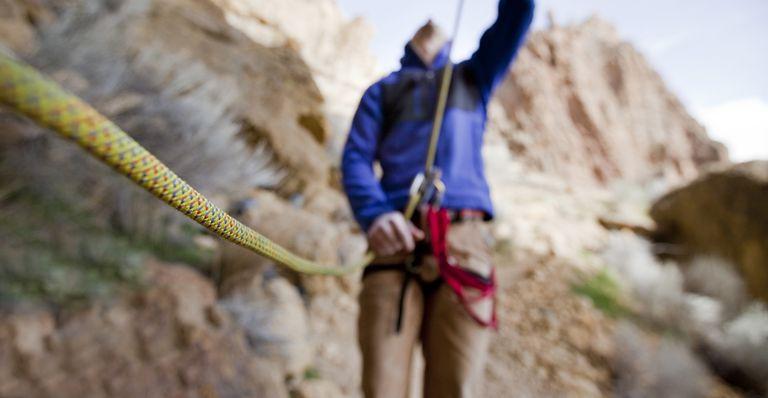 Man belaying his climbing partner