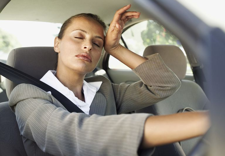 businesswoman sits in an overheated car