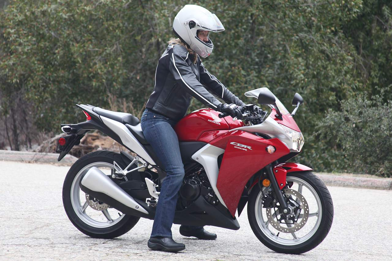 Woman warming up a motorcycle