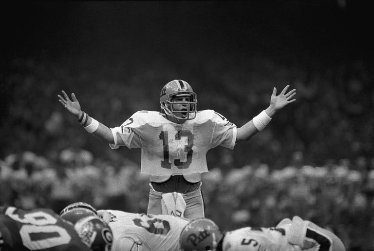 University of Pittsburgh quarterback Dan Marino attempts to quiet the crowd at the Sugar Bowl, 1982