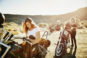 Motorcyclists on road trip preparing to ride