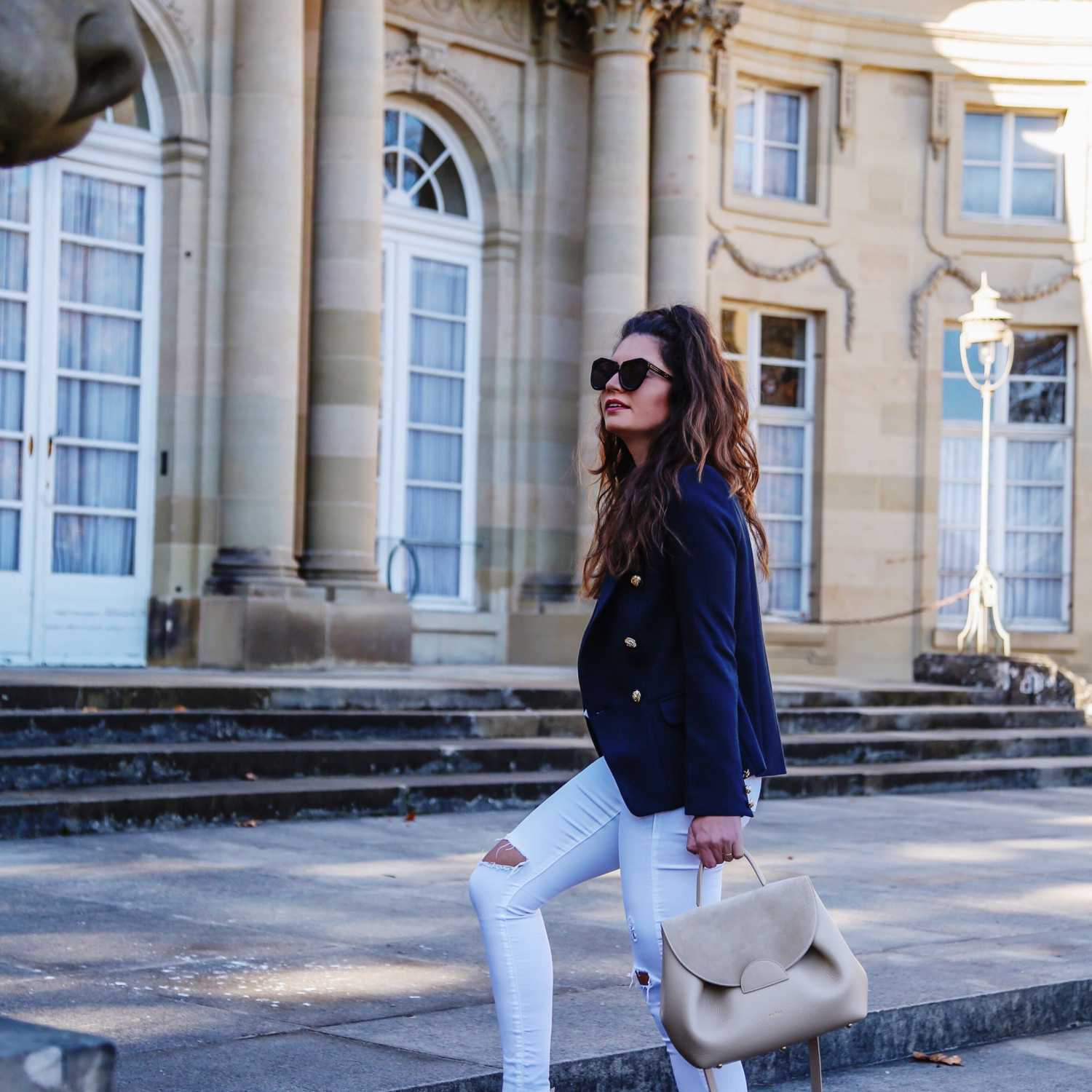 Woman in Navy Blazer and White Jeans