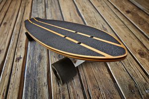 Dynamic view of a black and wooden skateboard