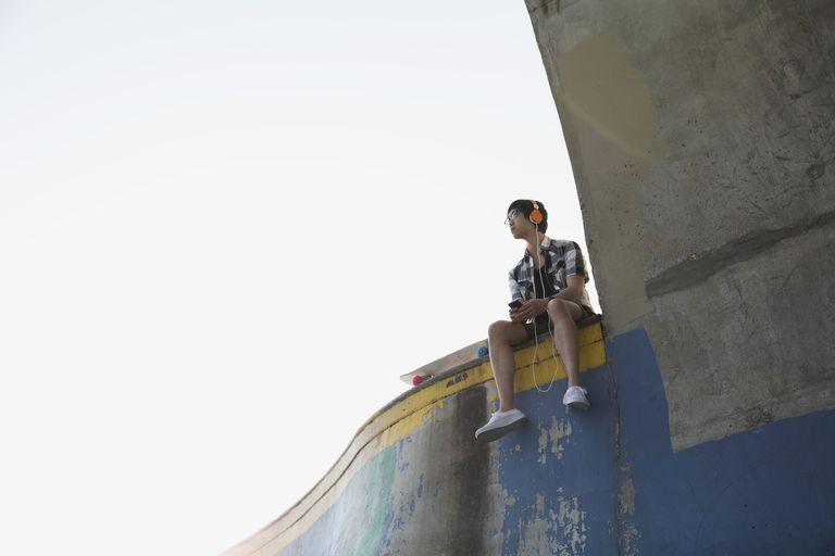 Teenage boy on ramp at skateboard park