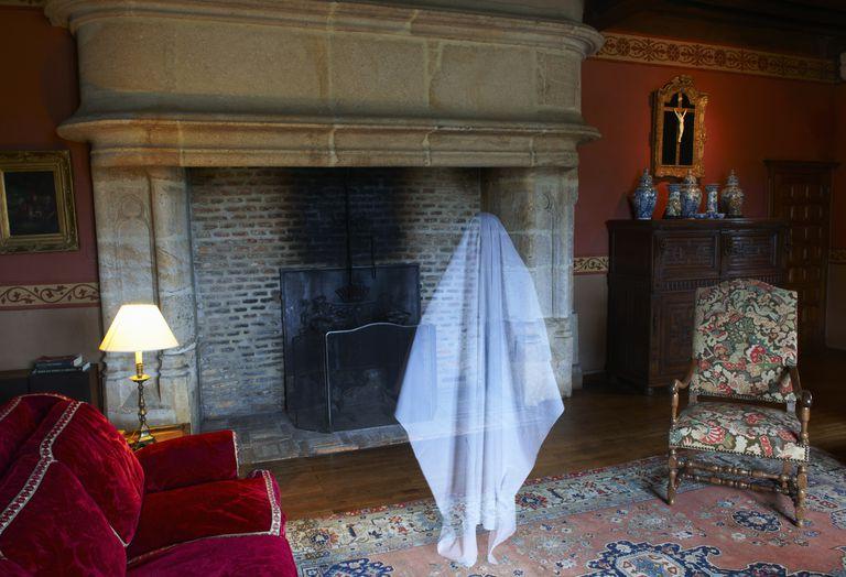 Ghost floating in ornate living room