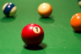 red 7-ball on billiards table