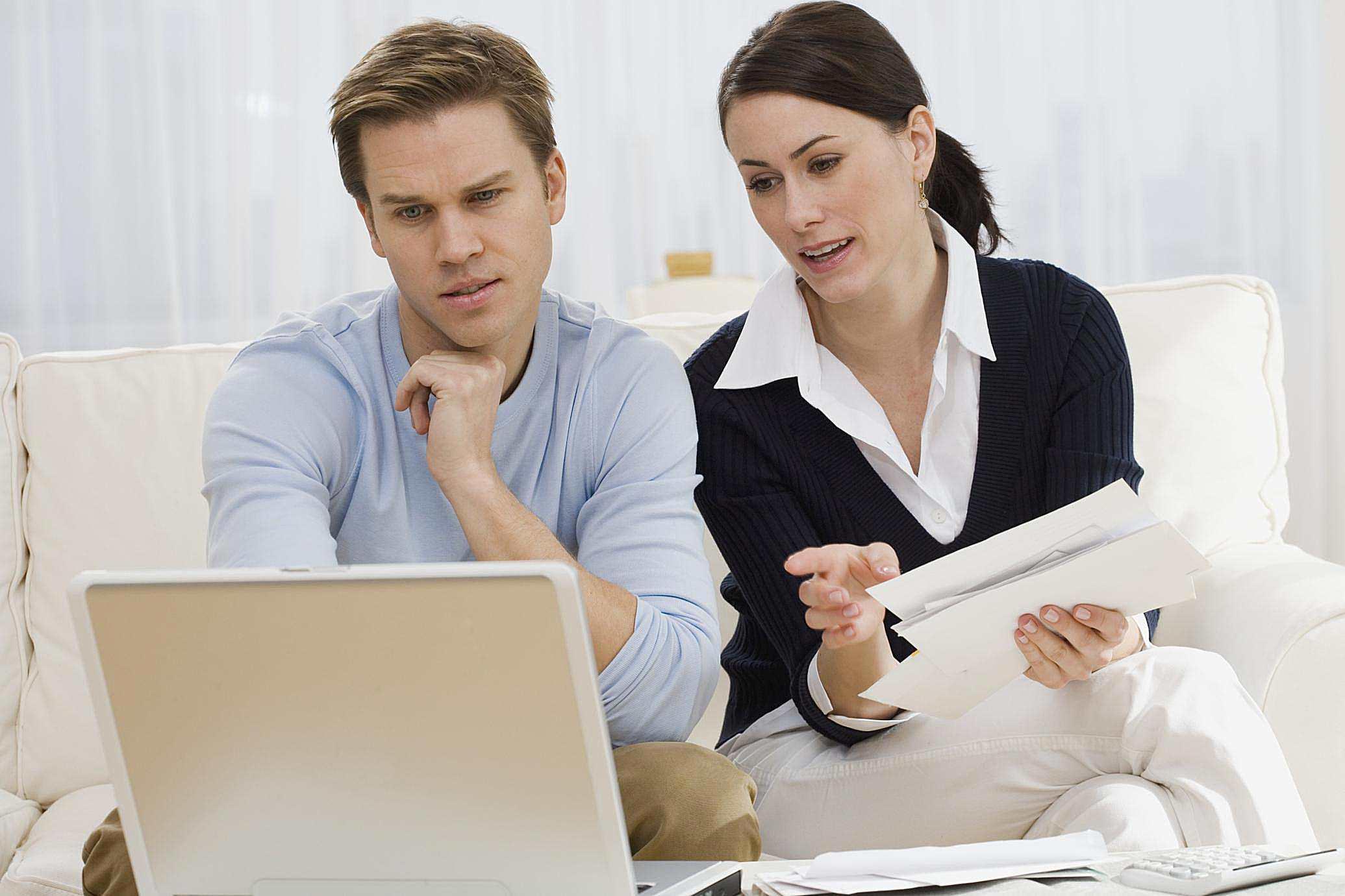 Couple paying bills on laptop
