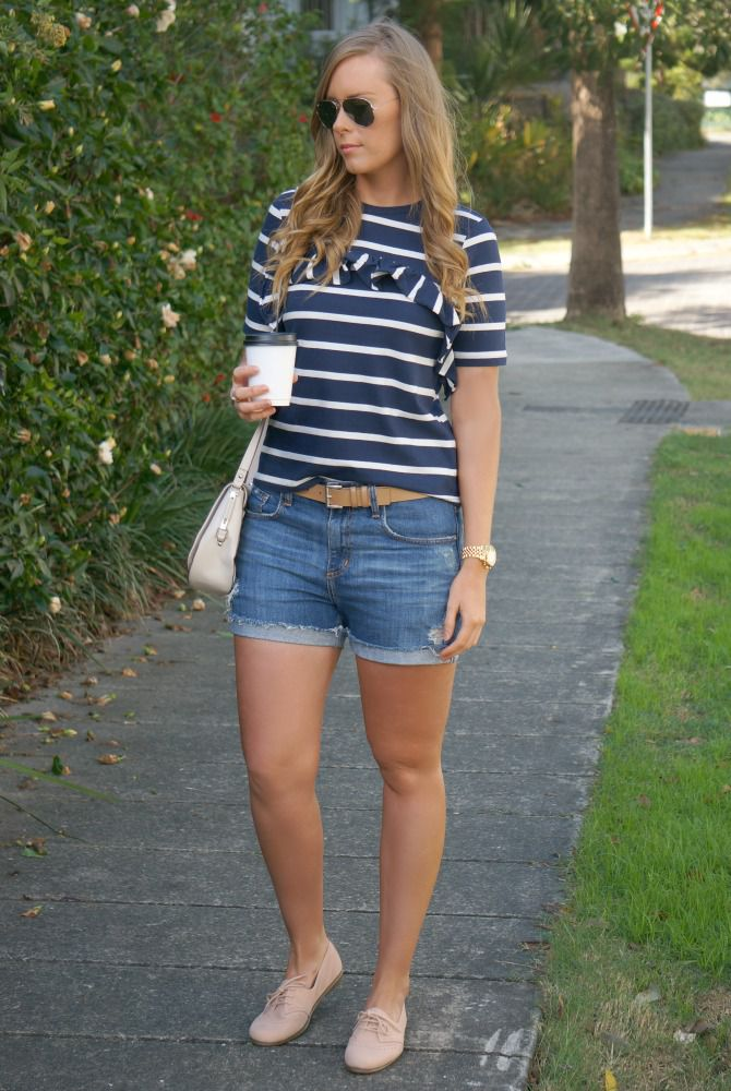 3fff19e4d03 Woman in striped t-shirt and denim shorts outdoors. Style Elixir