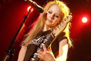 PERTH, AUSTRALIA - APRIL 6: Avril Lavigne performs on stage at the start of her Australian leg of the Bonez Tour at Challenge Stadium on April 6, 2005 in Perth, Australia.