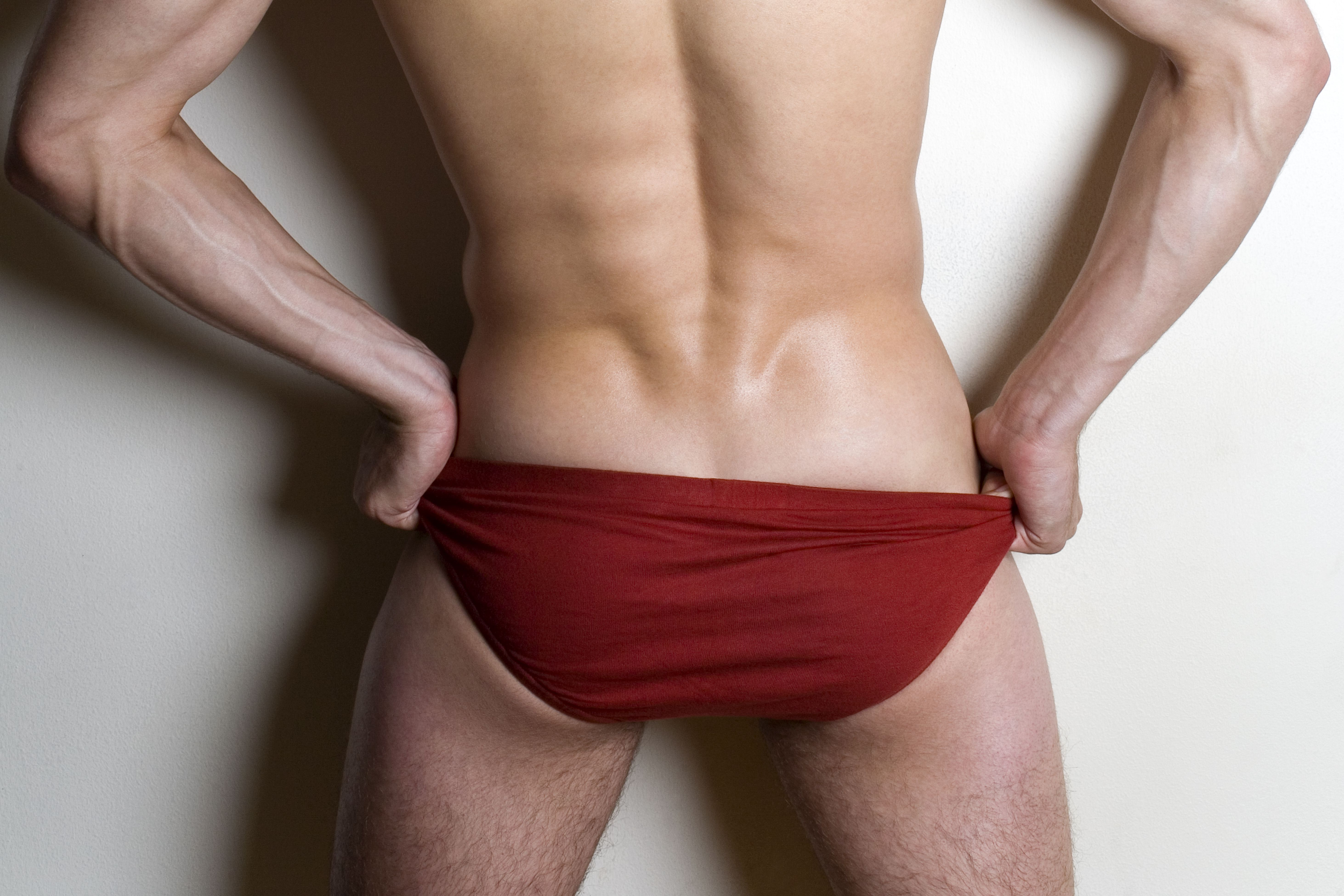 Close up of male buttocks in red underpants