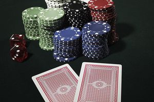 Playing cards with chips and dice