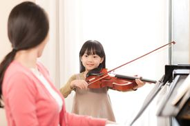 Playing music with mom.