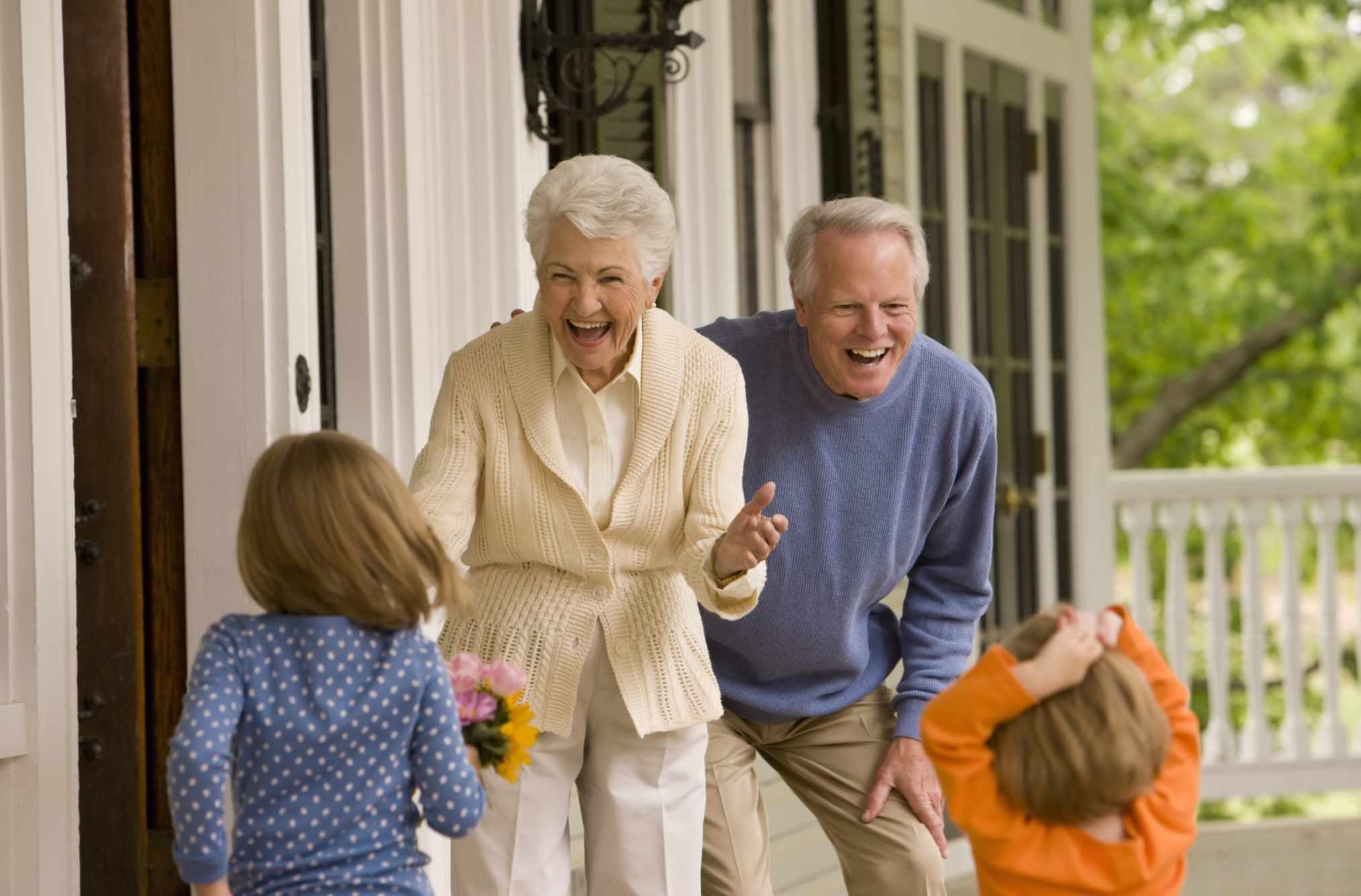 Grandparents being welcomed by grandchildren
