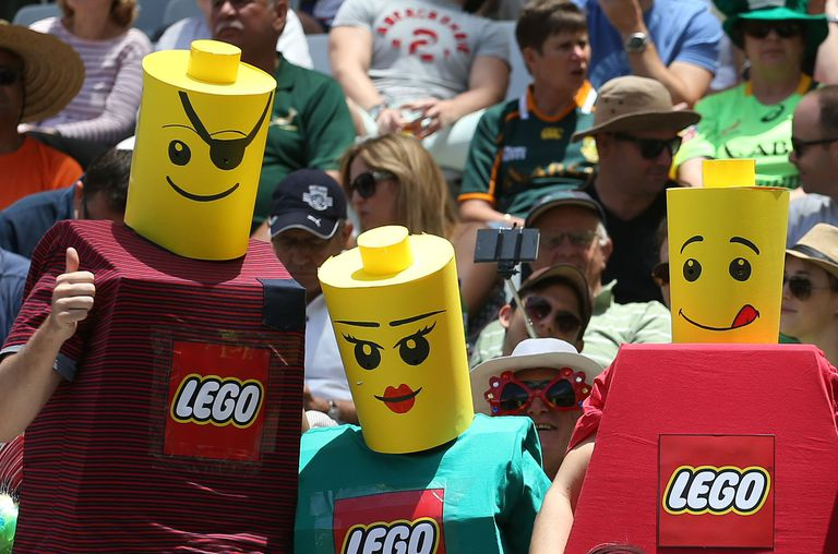 Fans dressed as lego men and women