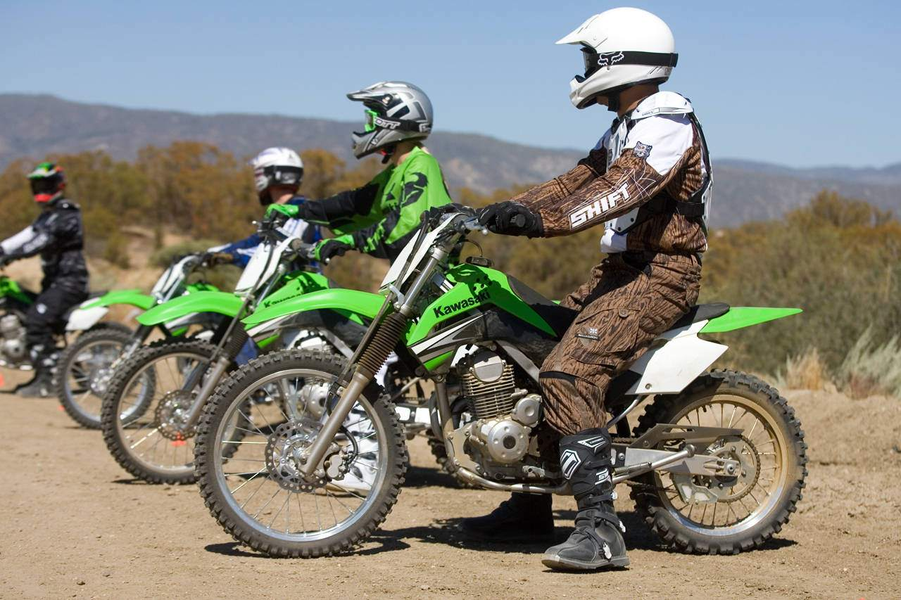 People lined up on dirtbikes