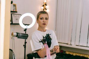 Female tattoo artist with short hair