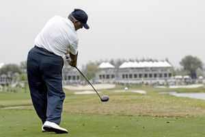 Lee Trevino hits his tee shot on the 18th hole during the first round of the Outback Steakhouse Pro-Am at the TPC of Tampa. Friday, February 24th, 2006