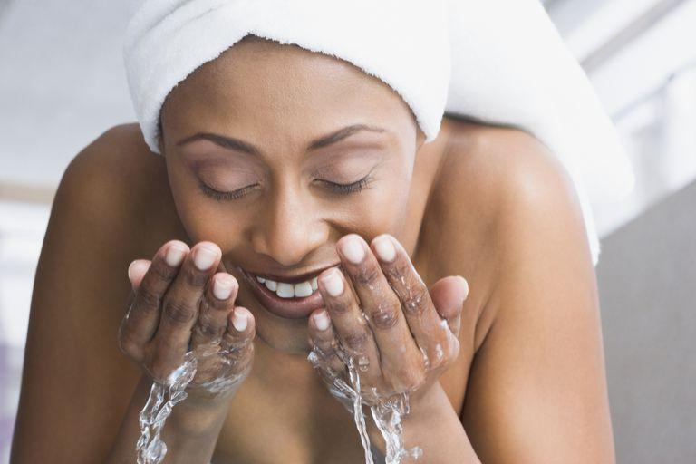 black woman washing face