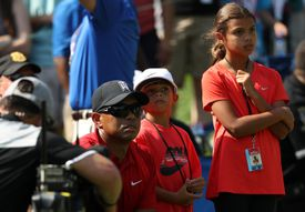 Tiger Woods looks on with his children Sam and Charlie during the final round of the 2016 Quicken Loans National