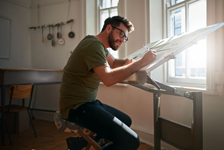 Artist drawing on an easel.