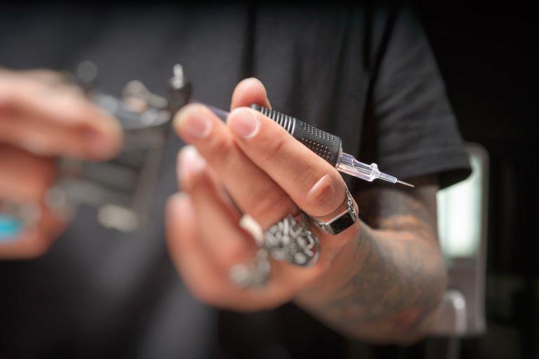Tattoo gun with needle in it