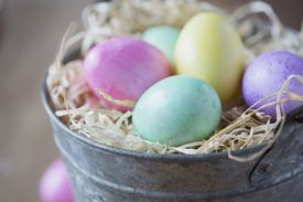 Close up of multicolor Easter eggs in bucket
