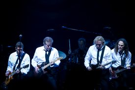 Glenn Frey, Don Henley, Joe Walsh, and Timothy B. Schmit, The Eagles, performing onstage.