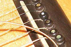 New Sixth String Inserted into Bridge