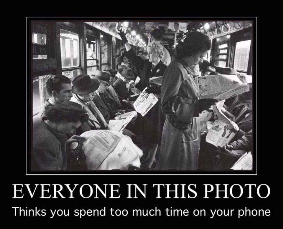 photo from the 50s of people reading newspapers on a bus